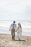Cheerful wedding couple on the beach Royalty Free Stock Photography
