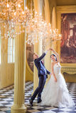 Cheerful wedding couple dancing in church Royalty Free Stock Photos