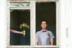 Cheerful wedding couple having fun outdoors on wedding day Royalty Free Stock Photography