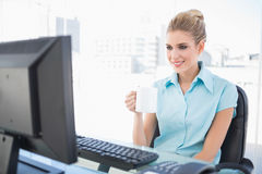 Cheerful well dressed businesswoman holding coffee Royalty Free Stock Photos