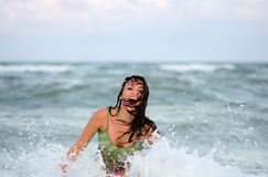 Cheerful wet young woman. In the sea Royalty Free Stock Photo