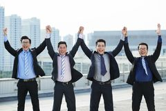 White Collar Workers Celebrating Project Completion Stock Image