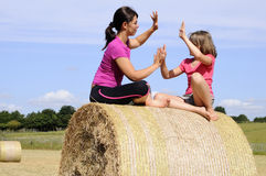 Cheerful white people having fun on hay bales Royalty Free Stock Photo
