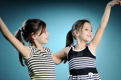 Cheerful White Twins Dancing Stock Photo