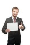Cheerful winking businessman holding sign Stock Photography