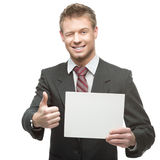 Cheerful winking businessman holding sign Stock Image
