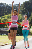 Cheerful winner athlete crossing finish line Royalty Free Stock Photography