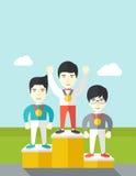 Cheerful winners on pedestal Stock Photo