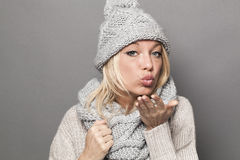 Cheerful winter woman expressing tenderness in pouting and kissing signs Stock Photography