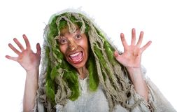 Cheerful witch. On a white background Stock Photo