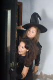 Cheerful witch Stock Images