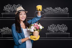 Cheerful womam watering flower Stock Images