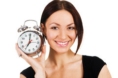 Cheerful woman with alarm clock Royalty Free Stock Photos