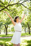 Cheerful woman with arms raised Stock Images