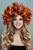 Cheerful woman with autumn leaves smiling, portrait.  royalty free stock photography