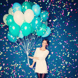 Cheerful Woman with  Balloons and Confetti Royalty Free Stock Images