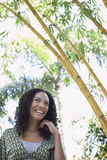 Cheerful Woman In Bamboo Forest. Cheerful young African American woman in bamboo forest Royalty Free Stock Photography