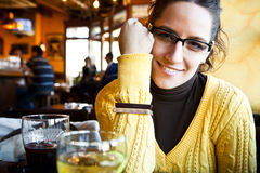 Cheerful woman in bar Stock Photography