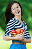 Cheerful woman basket apples Stock Photos