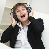 Cheerful woman with a big stereo headphones Stock Photo