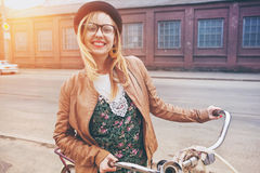 Cheerful  woman with bike Stock Images