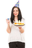Cheerful woman with birthday cake royalty free stock image