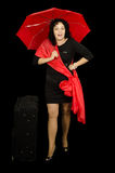 Cheerful woman in black dress with red umbrella Royalty Free Stock Image