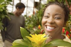 Cheerful Woman At Botanical Garden Stock Photo