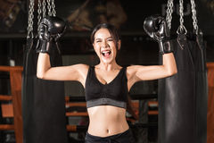 Cheerful woman in boxing gloves celebrating victory Stock Images