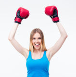 Cheerful woman with boxing gloves Stock Photo