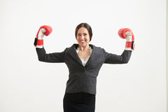 Cheerful woman in boxing gloves Royalty Free Stock Images