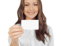 Cheerful woman with business card. Looking at camera Royalty Free Stock Image