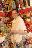 Cheerful woman buyer shopping Christmas ornaments Stock Photo