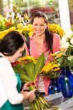 Cheerful woman buying bouquet flower shop florist Stock Photo