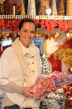 Cheerful woman buying Xmas decoration at shop Royalty Free Stock Photography