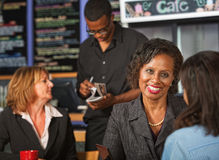 Cheerful Woman in Cafe Stock Photo
