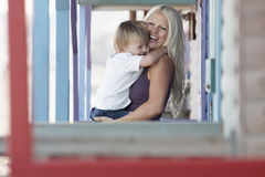 Cheerful Woman Carrying Son Royalty Free Stock Photos