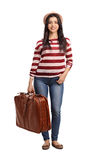Cheerful woman carrying a travelling bag Royalty Free Stock Photography