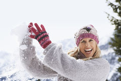 Cheerful Woman Catching Snowball Stock Photography