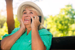 Cheerful woman with cell phone. Royalty Free Stock Photos