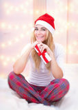 Cheerful woman with Christmas gift Stock Photos