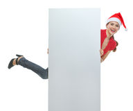 Cheerful woman in Christmas hat holding billboard Royalty Free Stock Photos