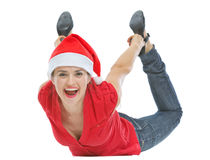 Cheerful woman with Christmas hat laying on floor Royalty Free Stock Photo