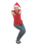 Cheerful woman in Christmas hat pointing in camera Stock Images