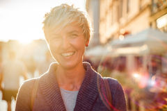 Cheerful woman in the city during summer royalty free stock images