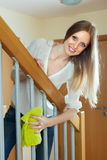 Cheerful woman cleaning  stair railings Royalty Free Stock Photography