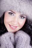 Cheerful woman clothing in warm hat. Stock Image