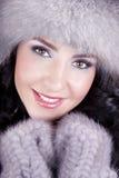 Cheerful woman clothing in warm hat. Winter season Stock Image