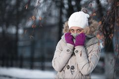 Cheerful woman clothing in warm hat. Winter season Stock Photography