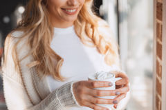 Cheerful woman with cocoa Stock Image